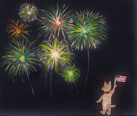 Puppy waves flag as he watches fireworks.