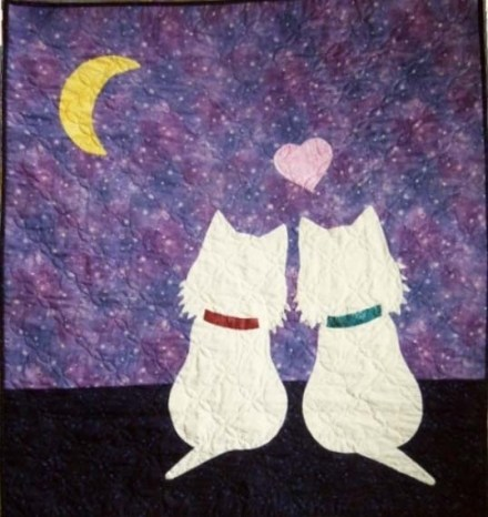 Little boy and little girl Westies admire the night sky together.