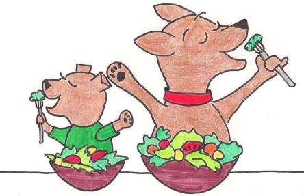 Two puppies happily eating their salads.