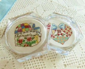 Handmade cross stitched patchwork hearts acrylic coaster set.