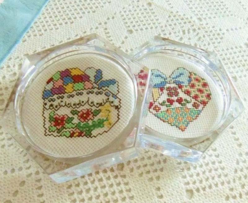 Handmade cross stitched patchwork hearts acrylic coaster set.