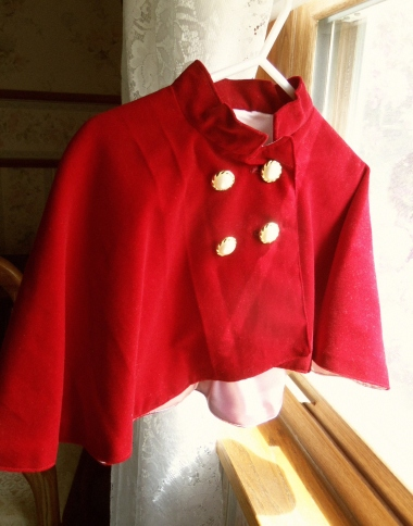 Red velveteen capelet for little girls.