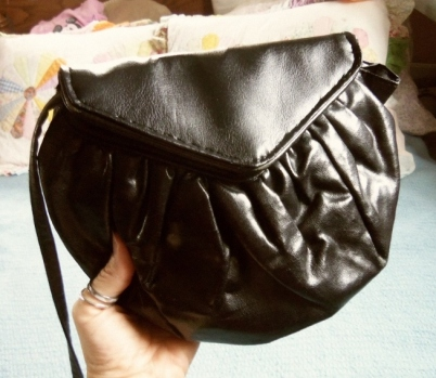 Small black Cream Puff purse with new black flap.
