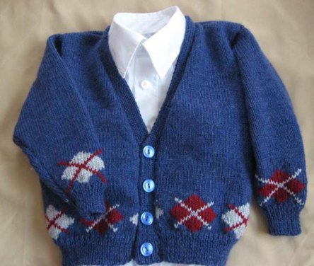 Boy's blue cardigan with red and white argyle accent