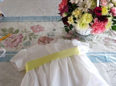 White eyelet dress with yellow sash