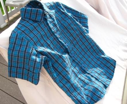 Boys' blue plaid short sleeved shirt.