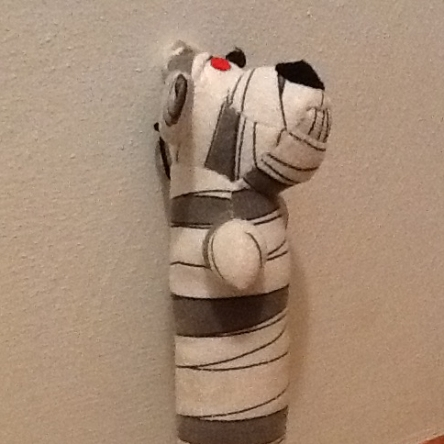 Side view of mummy Loofah dog toy
