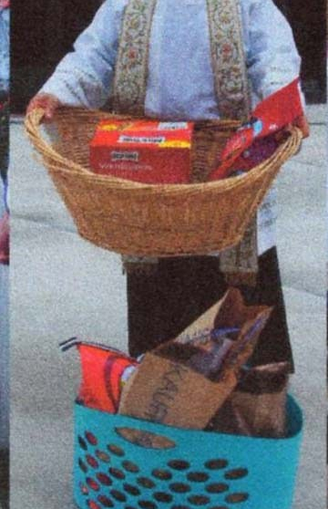 Priest with baskets of donations for local shelter.