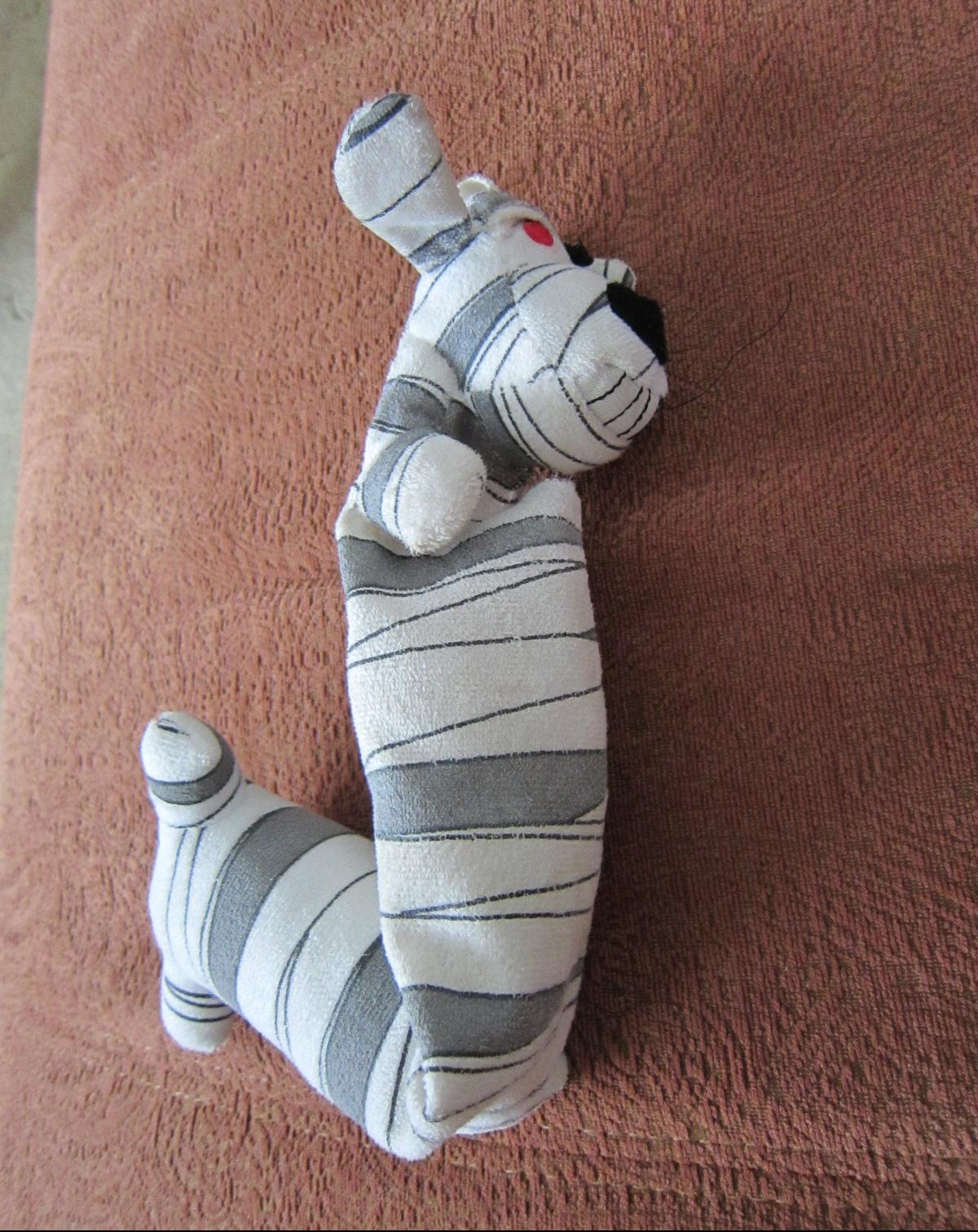 Unstuffed mummy loofah dog.