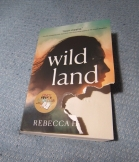 Chewed up cover of the book Wild Land.